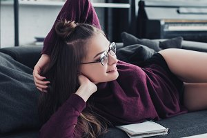 attractive girl lying on sofa and sm