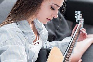 beautiful musician in shirt sitting