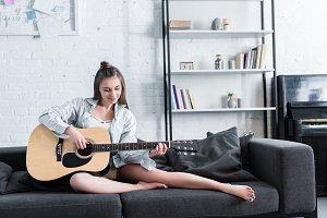beautiful musician sitting on sofa a