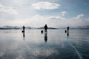 People skates on the Baikal lake