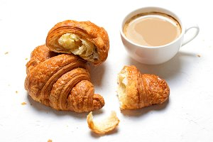 Croissants and Coffee Cup on White B