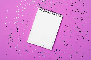 Blank Notepad on Purple Background a