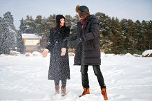 Young couple in love play with snow