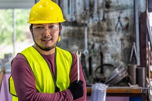Portrait of Asian machinist in safet