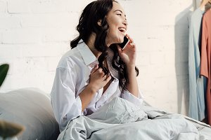 happy young woman in white shirt tal