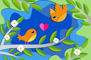 Birds in love on the blooming tree