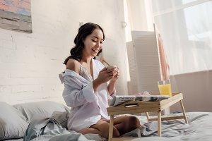 happy seductive asian girl in white