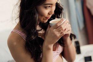 beautiful smiling asian girl in bra