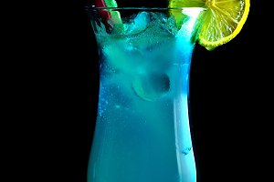 Alcoholic blue cocktails on a black