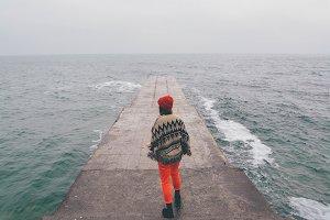 Girl walking near the winter sea