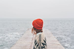 Woman walking on beach in winter