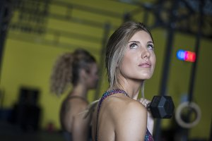 Beauty blonde woman training with du