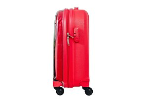 A red travel suitcase on wheels