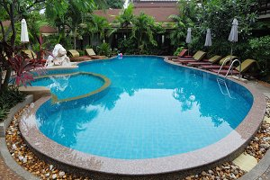 Whimsically curved pool with  clear
