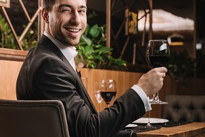 handsome man holding glass with red