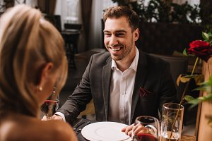 handsome man laughing in restaurant