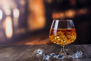 Glass of Cognac with ice cubes