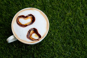 Cup cappucino with heart shaped