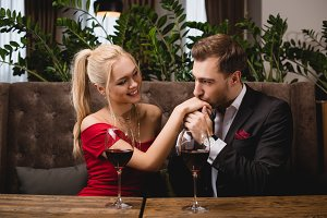 handsome man kissing hand of attract