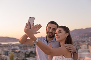 Young couple making selfie in front