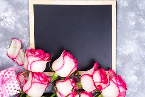 Frame composition with roses and