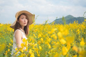 Young woman enjoying summer in field