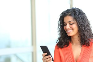 Woman holding a phone and browsing c