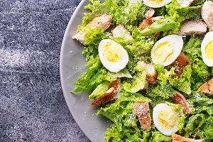 Caesar salad with eggs, chicken and