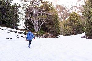 Child climbing a snowy mountain