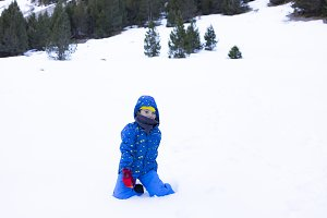Boy playing with the snow