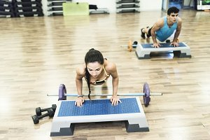 Man and woman training in gym class