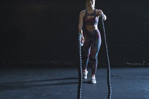 Woman training with rope at gym