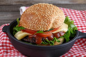 burger with a meatball and vegetable