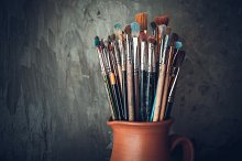 Artistic paintbrushes in a jug