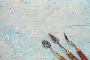 Palette knifes on artist canvas