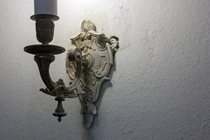 Antique wall lamp on a white wall