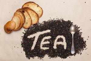 Dried tea leaves, a teaspoon and toa