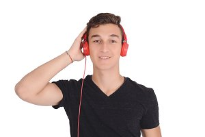 Portrait of smiling teen listening m