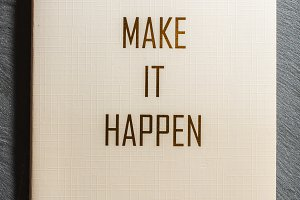 Make It Happen text on notebook