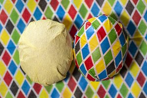 Easter egg wrapped with coloured pap