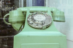 Vintage green telephone on store she
