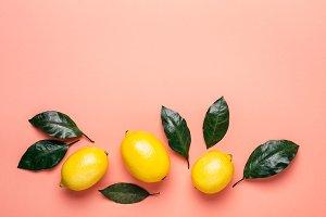 border of ripe lemons and leaves on