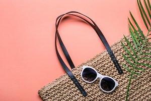 Stylish straw bag and sunglasses. Co