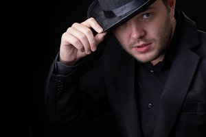 Picture of men in black hat on empty