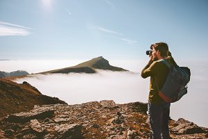 Man travel photographer with camera