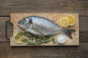 Dorado fish on cutting board.