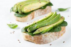 Two ciabatta toast with sliced avoca