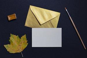 Autumn leaf with golden envelope
