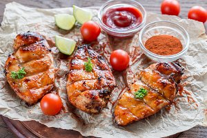 Grilled chicken breasts in hot sauce