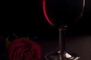 Romantic still life. Wine and rose